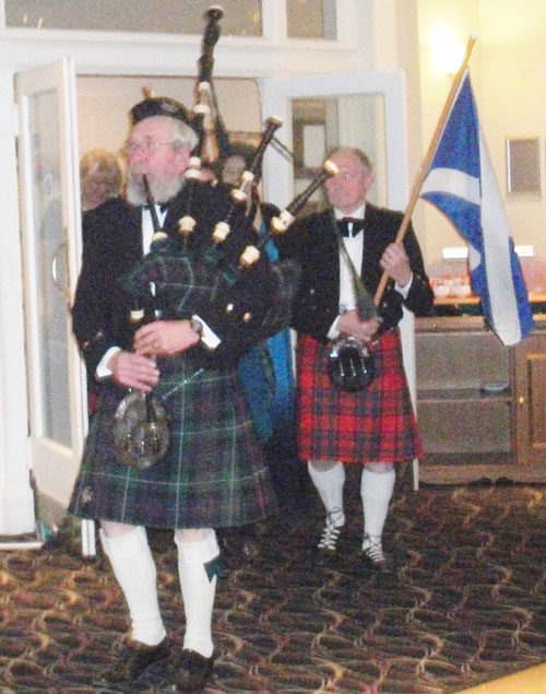 BURNS NIGHT 2014. Piper and flag bearers lead in the guests, Mayor of Bournemouth Cllr Dr. Rod Cooper and Mayoress